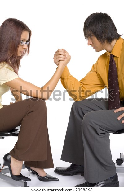 Woman and man arm wrestling. Isolated on white in studio.