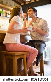 Woman and man with coffee in caf_ laughing