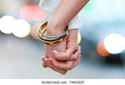 woman and man hand holding together