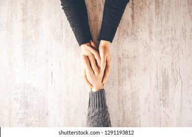 woman and man hand on wooden table background
