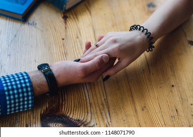 Woman and man have a date. Male and female hands on table. Rendezvous and coffee break concept. Happy couple in love. Concept couple lover valentine day. pre wedding.