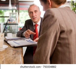 woman and man having discussion at bar