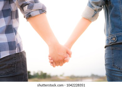 Woman and man holding hands, Happy couple holding hand in hand love in the parks, Expressing love. concept couple lover valentine day.