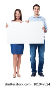 Woman and man holding a placard
