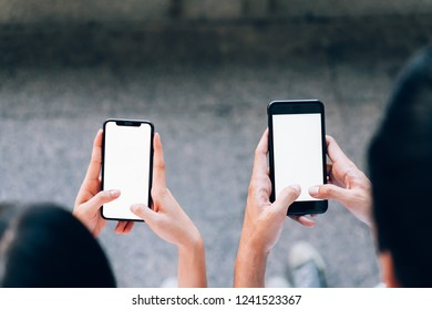 woman and man  holding a smartphone, mock up of blank screen. using cell phone on lifestyle. Technology for communication concept.