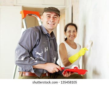 woman and man makes repairs in home together