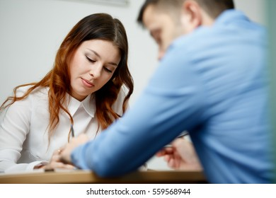 Woman with man at office