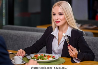 woman and man on business lunch
