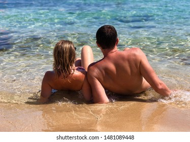 Woman and man on the summer beach. Happy couple.