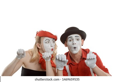 Woman and man peeking over an invisible fence. Big eyes, awe and amazement. Emotional mime couple on white.