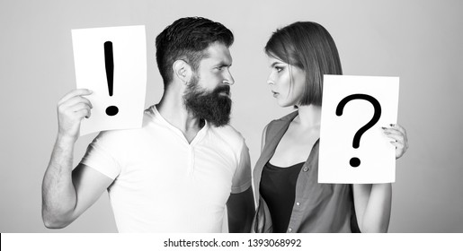 Woman and a man a question, exclamation point. Quarrel between two people. Pensive man and a thoughtful woman. Couple in quarrel. Question mark. Black and white.