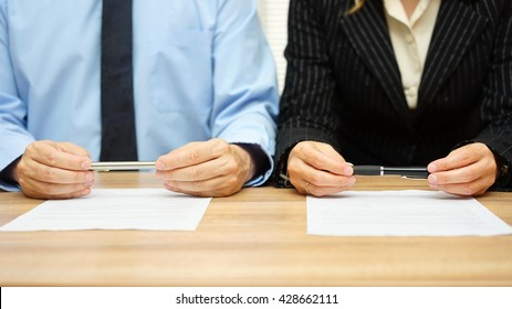 Woman and man are reading agreement on meeting