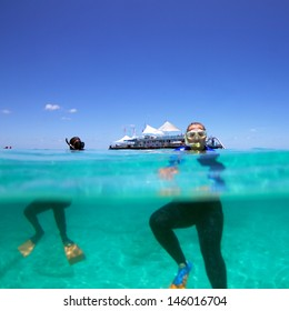 Woman and man snorkeling on Great Barrier Reef