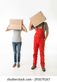 woman and man standing and holding cardboard boxes on top of their heads, on white background. copy space available
