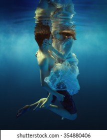 Woman and man swimming underwater