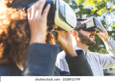 Woman and man wearing virtual reality headset. Business couple holding the device. Future and technology concepts.