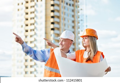 woman and man working as architects background house against the sky