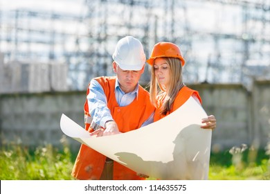 woman and man working as architects on a construction site