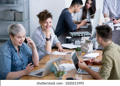 Woman and man working in the international company. Businesswoman talking on the phone