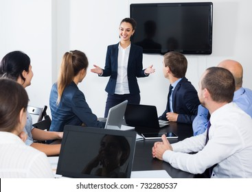 Woman manager making presentation during business meeting in office