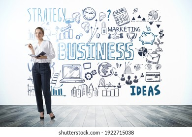 Woman manager standing near business strategy plan on concrete wall, doodle sketch set in office room with wooden floor. Business finance chart graph, success achieving