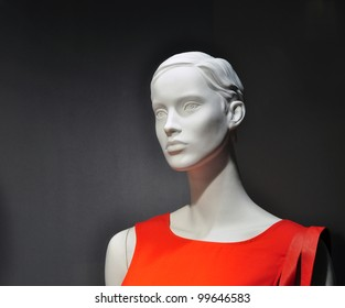 Woman mannequin in red dress, fashion shop