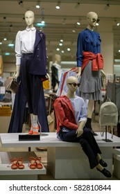 Woman mannequins in fine art style clothes in store