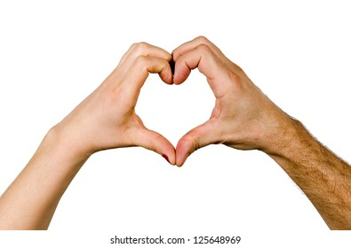 A woman and a man's hand making a heart