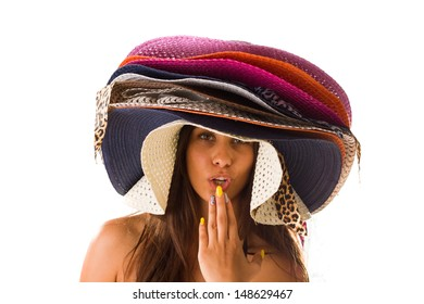 Woman with many summer beach hats on her dead