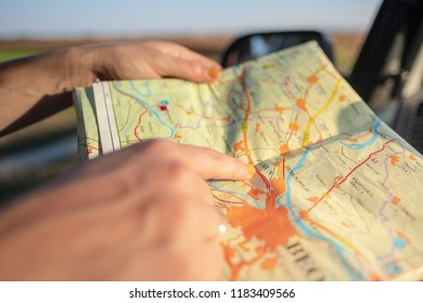 woman with map in road trip, hiking in nature