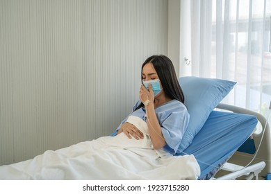 Woman in mask coughing from her lungs infected with COVID-19