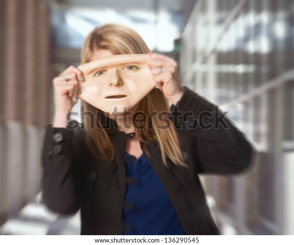 Woman with mask of human face and eyes