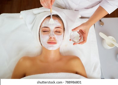 Woman in mask on face in spa salon.