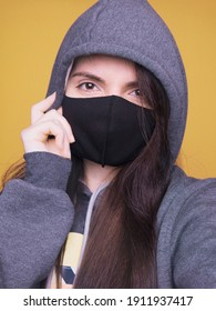 woman with mask on yellow background