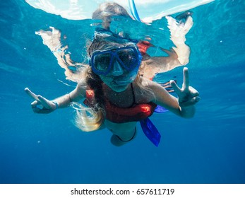 woman with mask is snorkeling in the ocean. diving. underwater