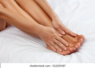 Woman massage her tired feet, healthy skin