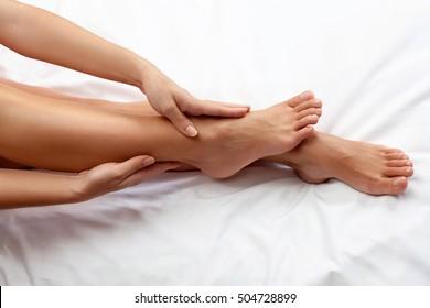 Woman massage her tired legs