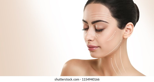 Woman with massage lines on perfect face, copy space