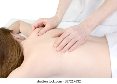 Woman at massage in a spa center, on a massage table
