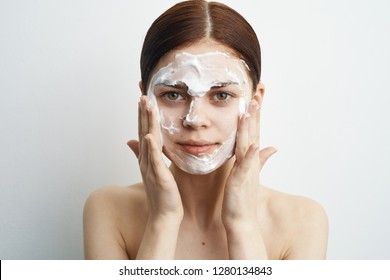 woman massages healthy skin face