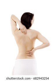 Woman massaging back pain on white background