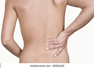 Woman massaging lower pain back, isolated on white background