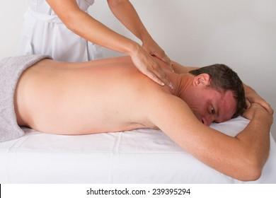 Woman massaging a man