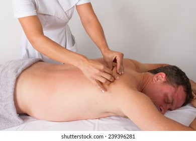 Woman massaging a man