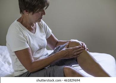 Woman massaging painful knee