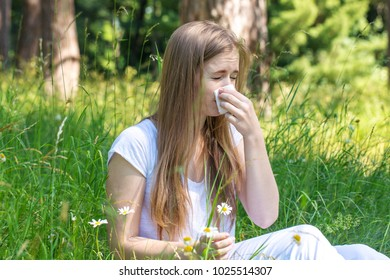 Woman in the meadow sneezes, the concept of an allergy