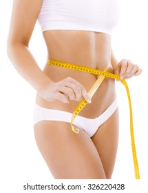 Woman measuring her slim body isolated on white background