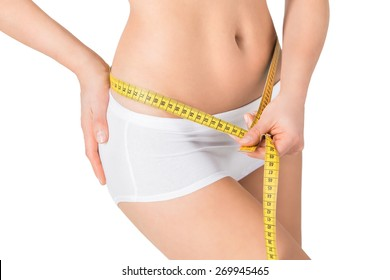 Woman measuring her waistline. Perfect slim body. Healthy lifestyles concept.