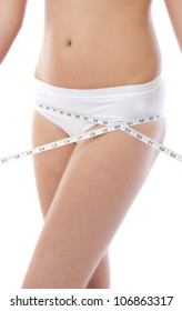 Woman measuring perfect shape of beautiful hips. Healthy lifestyles concept.