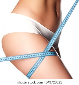 Woman measuring perfect shape of beautiful hips. Healthy lifestyles concept. Woman body part is being measured. Spa beauty part of body. Healthy lifestyle diet and fitness Perfect waist, butt and legs